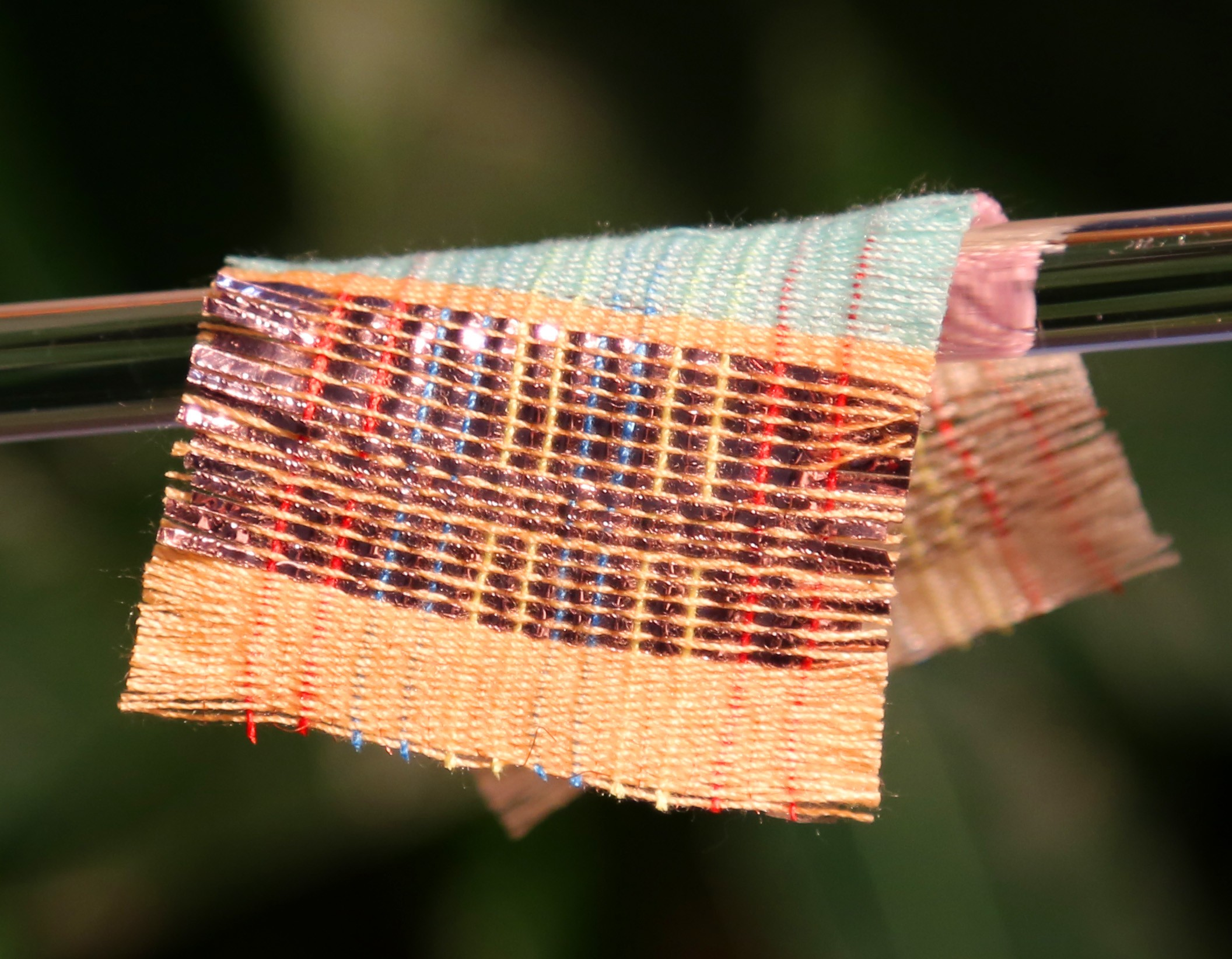 New Fabric Generates Electricity from Both Motion and Sunshine