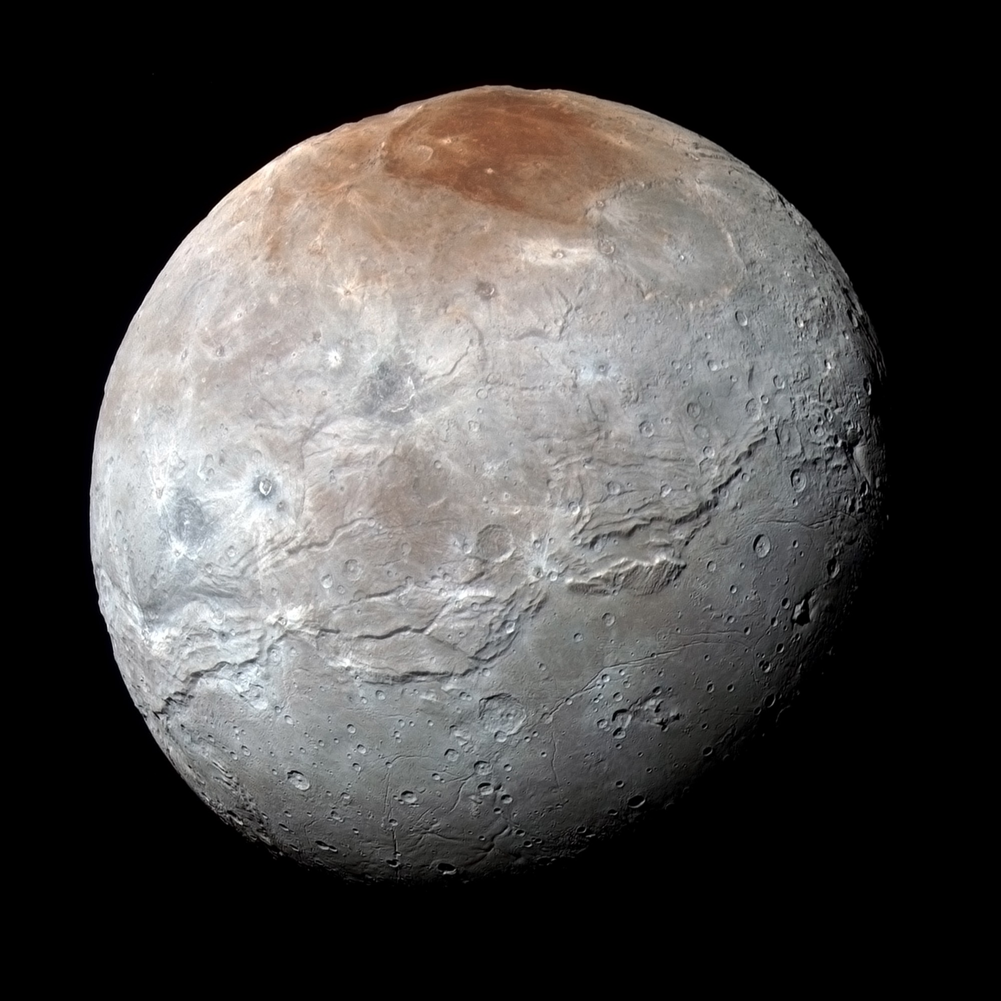 How Pluto Spray-Paints Charon Red Like a Graffiti Artist