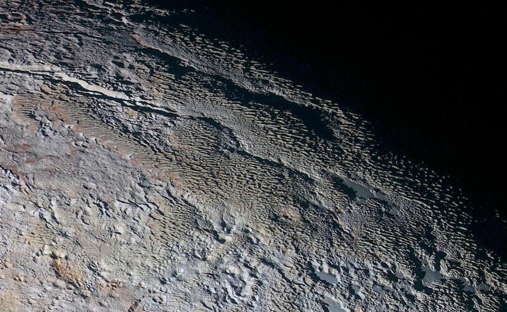 New Bizarre Images of 'Snakeskin' Terrain on Pluto